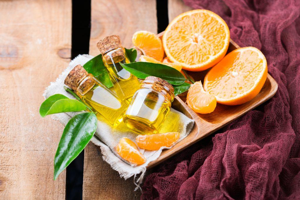 Fruta laranja, óleo de laranja e fruta mexerica